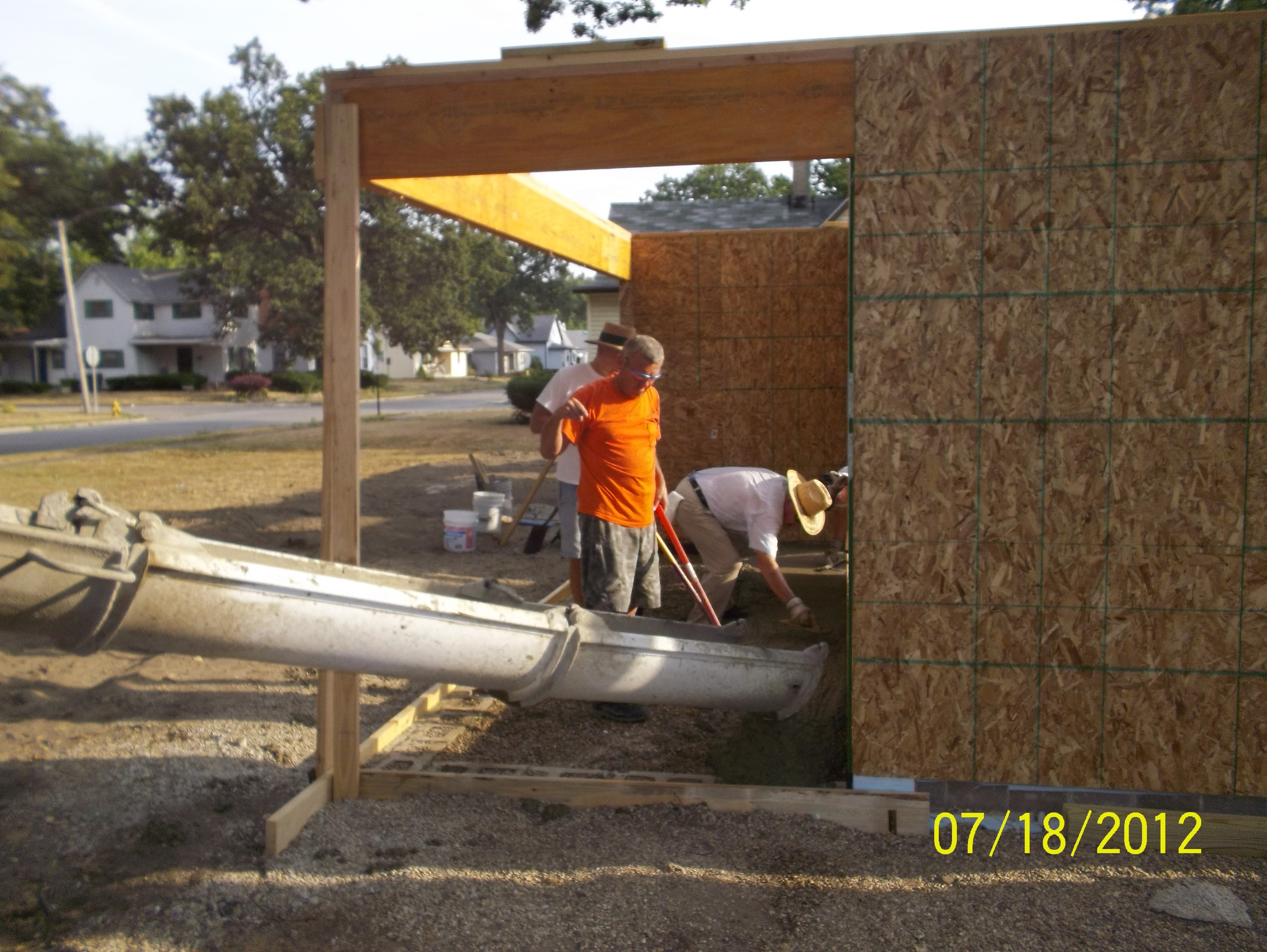 Pouring cement for porch and roof deck complete