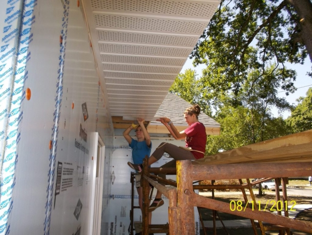 DACC staff and students install soffits