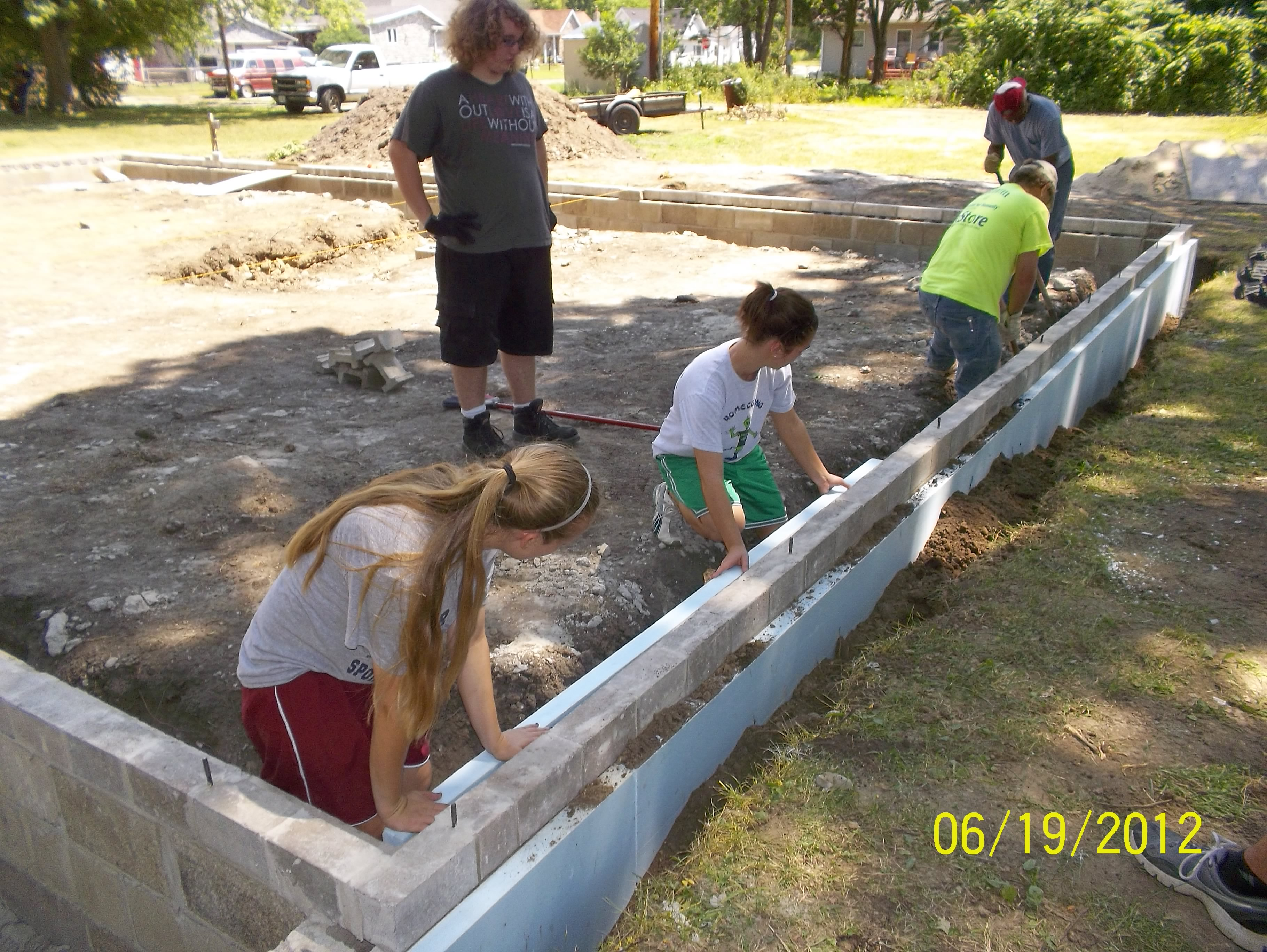 Second Church of Christ Mission Trip students build Sean's foundation