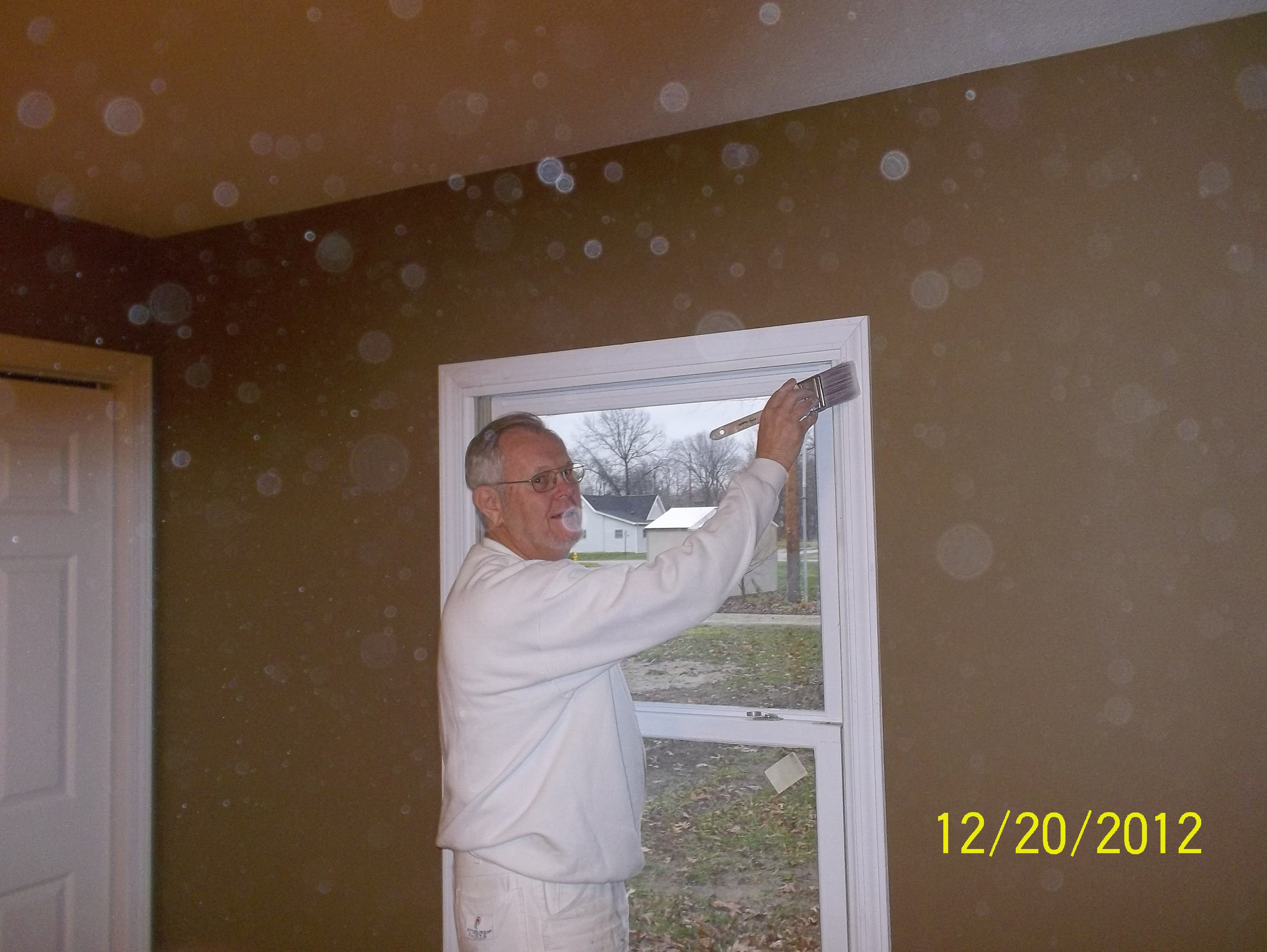 Jim Delattre of Delattre Painting donates his time to place the finishing touches on the master bedroom