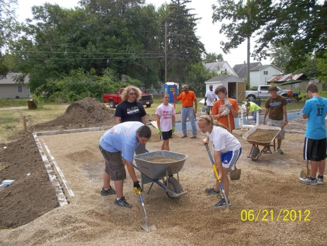 2CC Mission Trip gang spread pea gravel and meet Sean